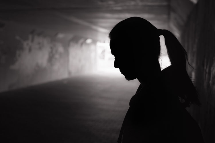 woman in dark tunnel