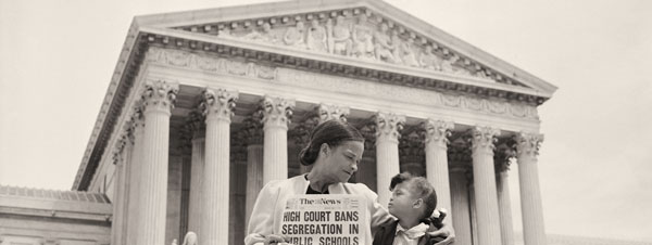 Mother and child sit before the State Supreme Court after the decision is passed