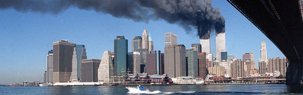 9/11 horizon shot of Manhattan with the twin towers in flames