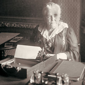 Dr. Anna Howard Shaw at desk