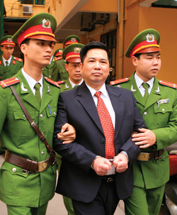 lawyer being escorted by Vietnamese police