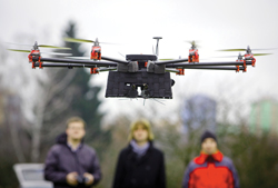 quad-copter drone looms in a neighborhood