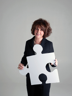 Sheila Gutterman portrait with puzzle piece