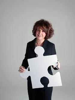 Sheila Gutterman portrait with puzzle piece