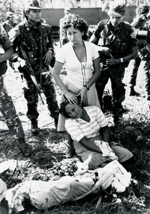 A woman grieves for her son killed in a guerrilla attack in El Salvador, 1984.