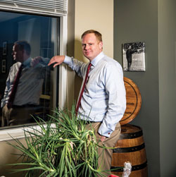 man in office by window and plant