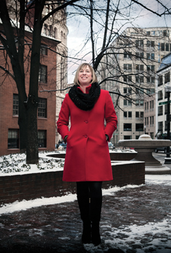 woman red coat downtown in snow