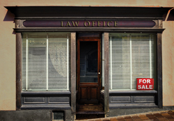 small law firm with for sale sign in window