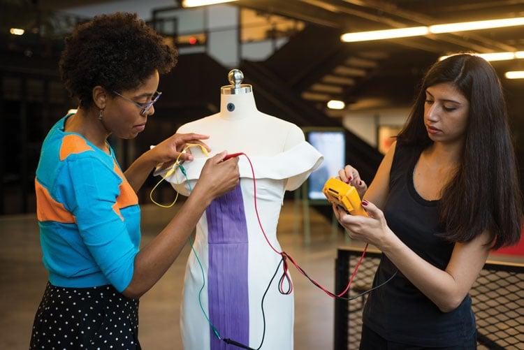 women measuring a dress