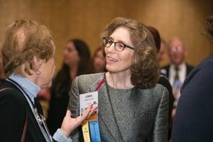 Linda Klein talking in a crowd