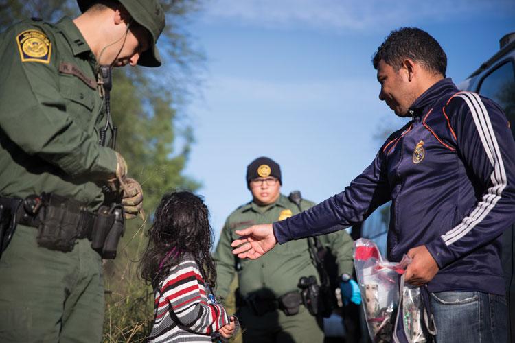 Border patrol stops a family.