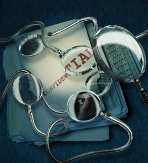 case files under magnifying glasses