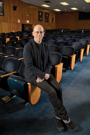 Smiling man in an empty theater