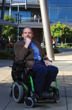 man in wheelchair in a courtyard