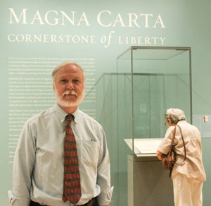 Portrait of Ward in front of Magna Carta exhibit