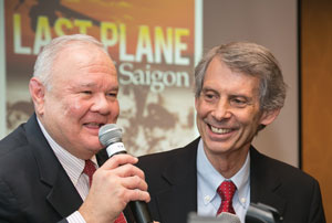 two men smiling with microphone
