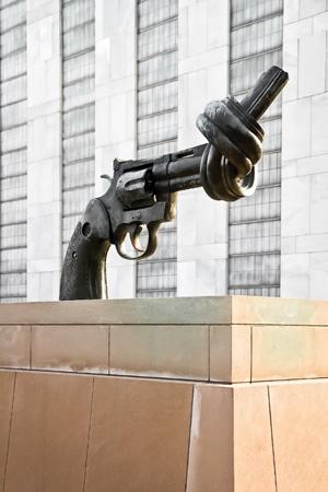 sculpture of a gun barrel tied in a knot
