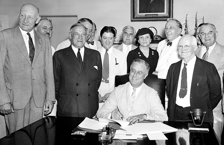 FDR and Frances signing bill into law at White House