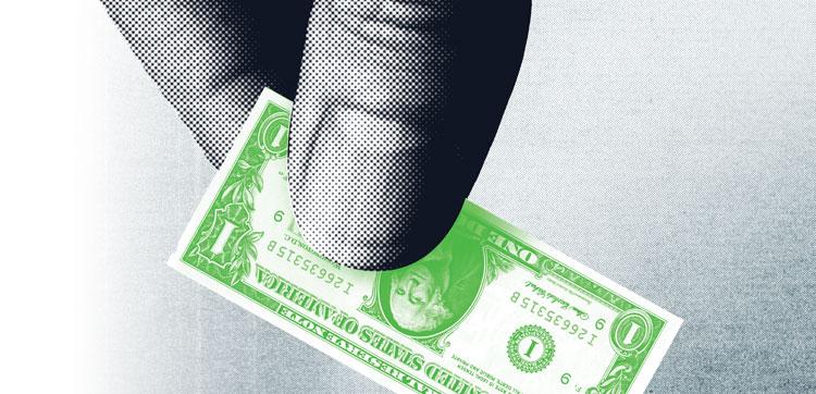 Fingers holding a dollar bill