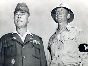 Japanese Gen. Tomoyuki Yamashita is escorted by a military policeman in Manila in 1945 at his arraignment for war crimes.