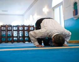Nubani takes time out for prayer  at Dar al-Hijrah mosque.