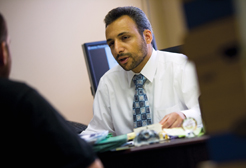 He confers with a client at the Annandale, Va., offices he shares with Hassan Ahmad, an American of Pakistani descent.