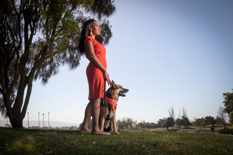 woman in the park with dog