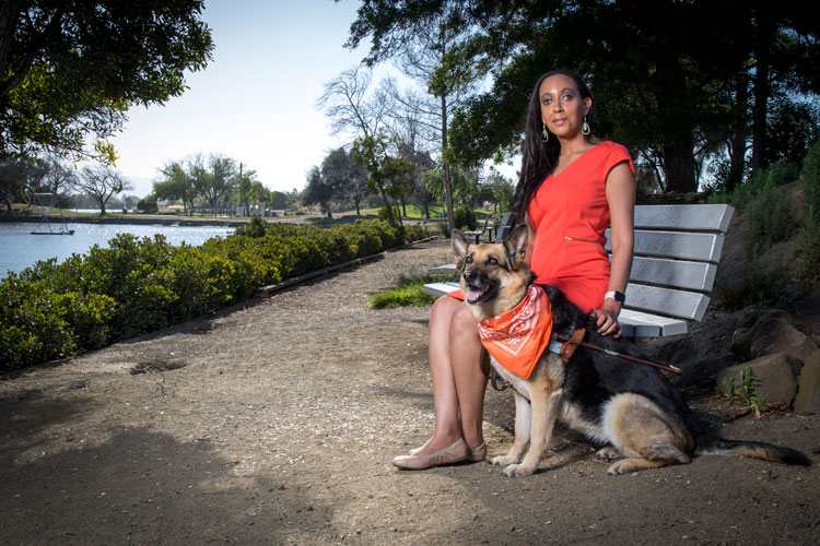woman on park bench with dog
