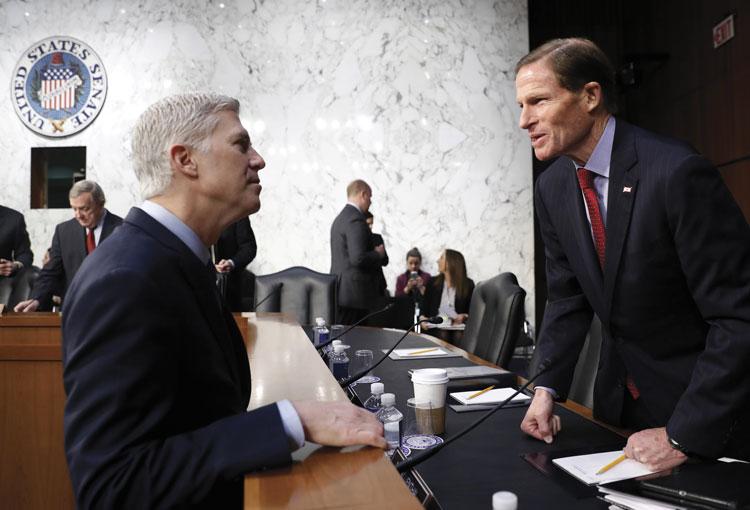 Neil Gorsuch talks with Richard Blumenthal