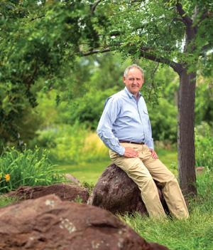 Pat Goetzinger sits on a rock in the wilderness of South Dakota