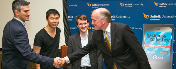 James Sandman congratulates the third-prize winners