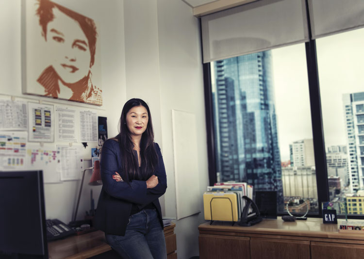 woman in office with nice view and arms folded