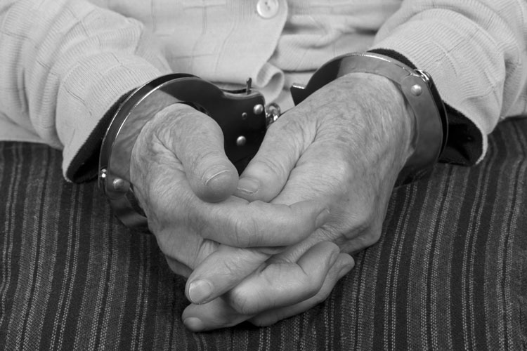 Elderly hands cuffed