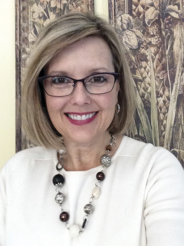 woman in glasses smiling