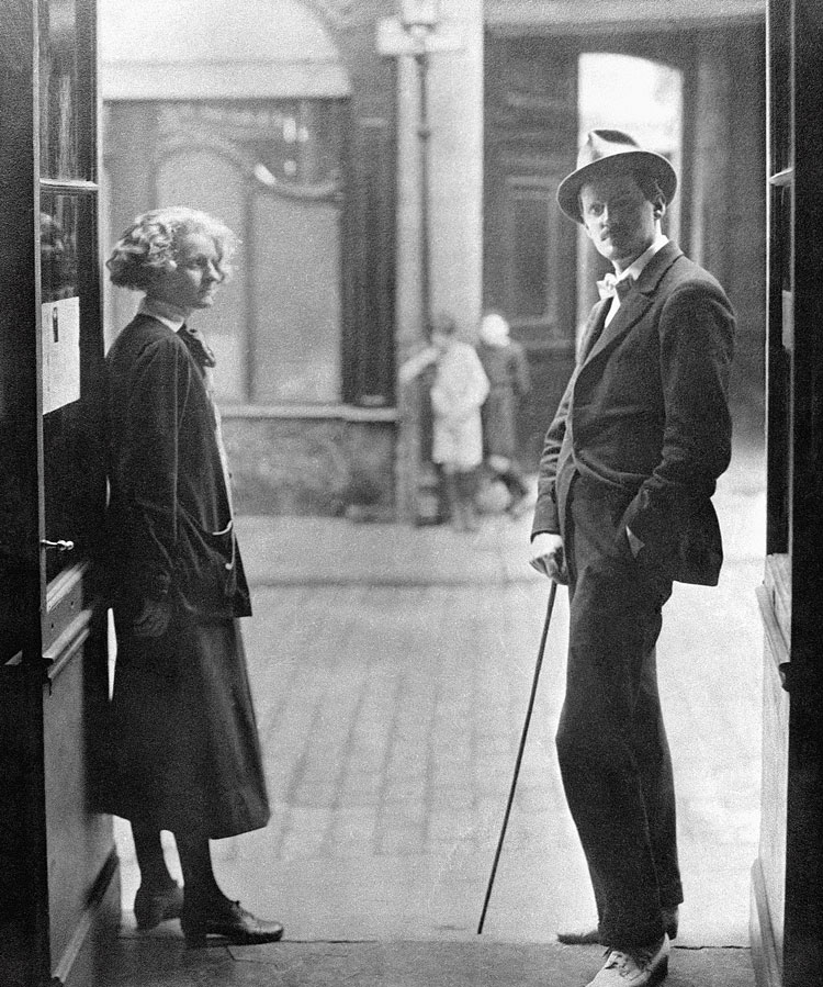 James Joyce standing in Paris with publisher
