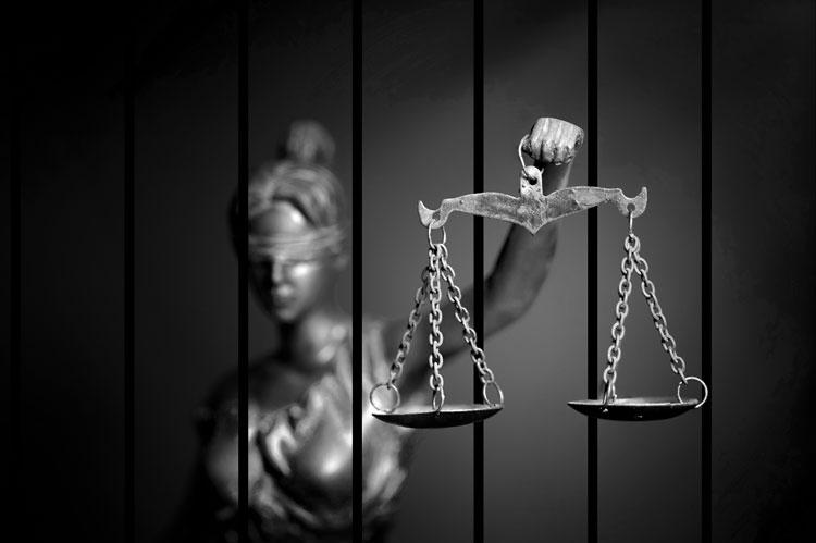 lady justice behind bars