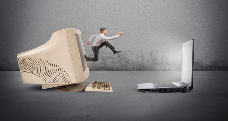 Man jumping from old computer to new computer