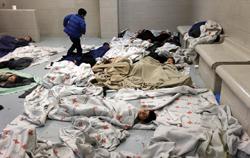 Central American kids sleep on a floor in Brownsville, TX