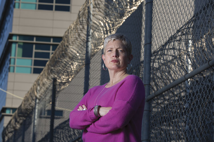 woman standing in front of prison gates