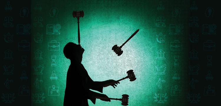 man juggling gavels