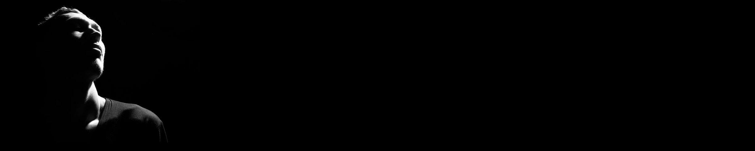 Teen on dark background