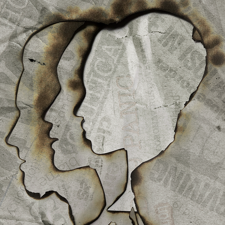Burnt-out silhouettes of womens' heads