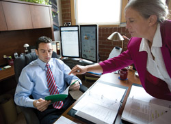 David Mills runs his practice out of his home office with the help of one part-time paralegal -- his mother, Elisabeth. (Photos by Wayne Slezak)
