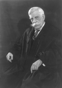 Are the legacies of Oliver Wendell Holmes in a 'head-on-crash'?