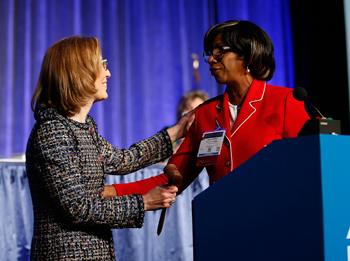 Paulette Brown passes gavel to Linda Klein