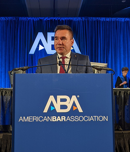 Canadian Bar Association president Brad Regehr stands at a podium