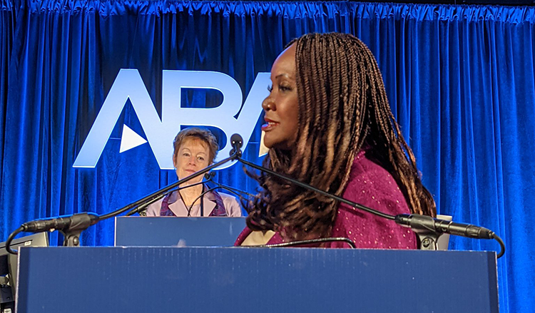 Deborah Enix-Ross in profile delivering a speech to the House of Delegates