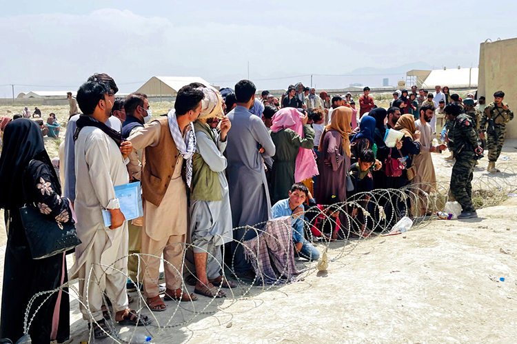 Afghans waiting in lines at the Kabul airport