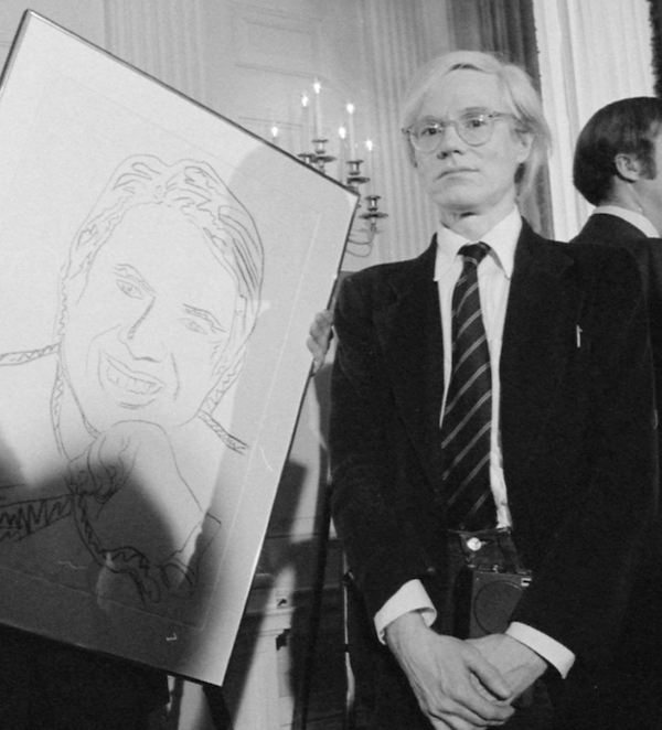 Andy Warhol standing in 1977