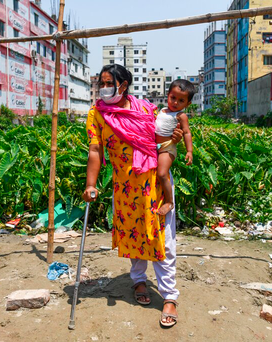 Garment worker holds her child